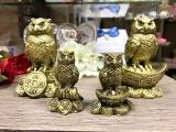 Сова на монетах - символ мудрости, богатства